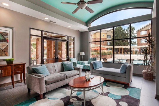 Cierra Crest Apartments - Clubhouse Lounge Area with Ceiling Fan and Swimming Pool Overlooking